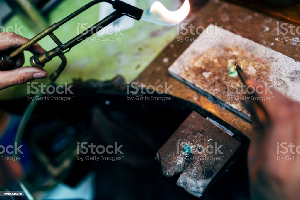 Jeweler working on ring in his workshop stock photo