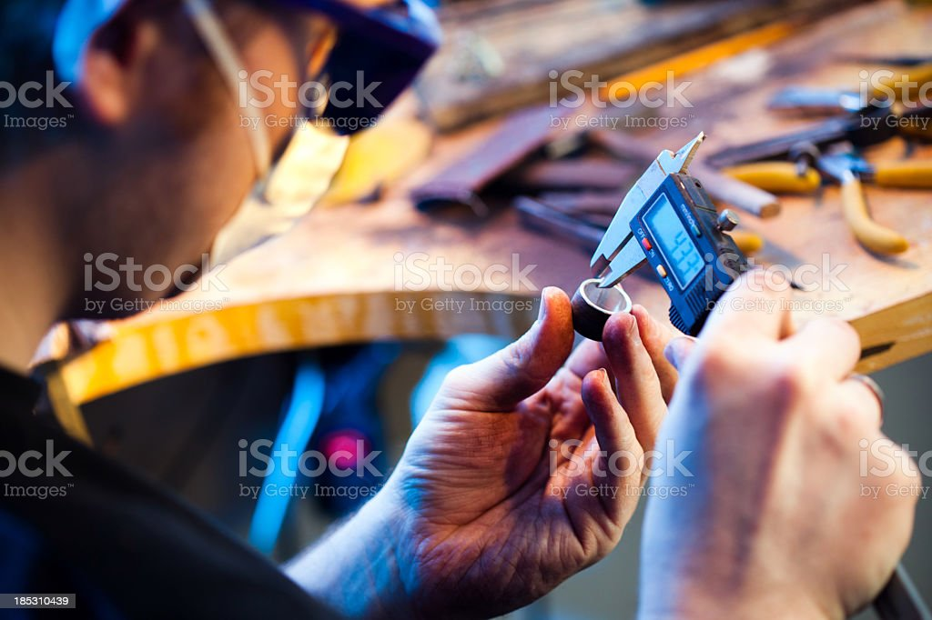 Jeweller measuring a ring stock photo