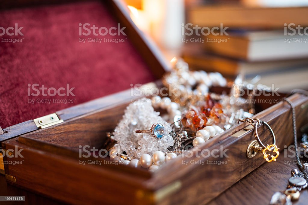 Jewelry box and jewelry on a wooden background stock photo