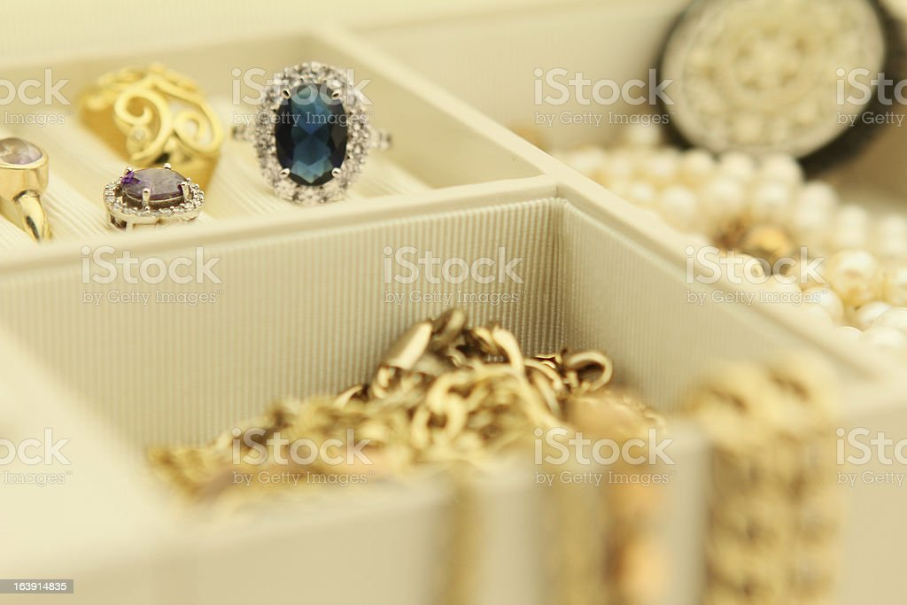 Jewelry box filled with rings and necklaces stock photo
