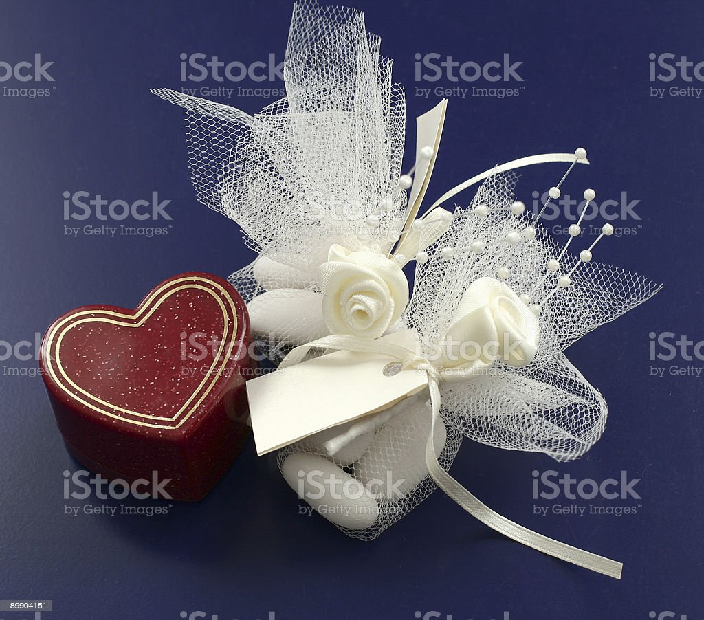 Jewelry Box in hearth shape, candies and sattin roses royalty-free stock photo