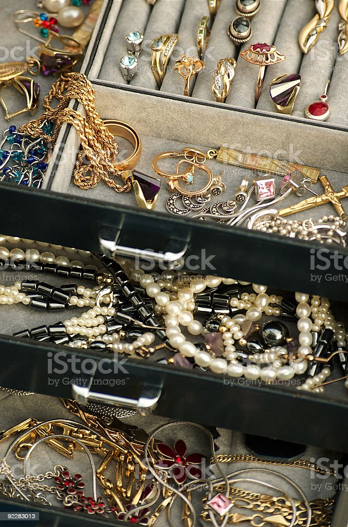 A jewelry box with gold, pearls and stone stock photo
