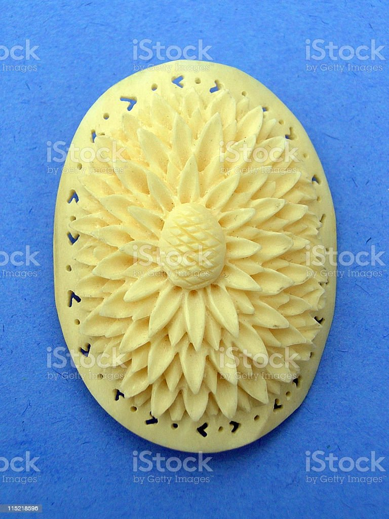 Jewelry: Carved ivory sunflower. stock photo