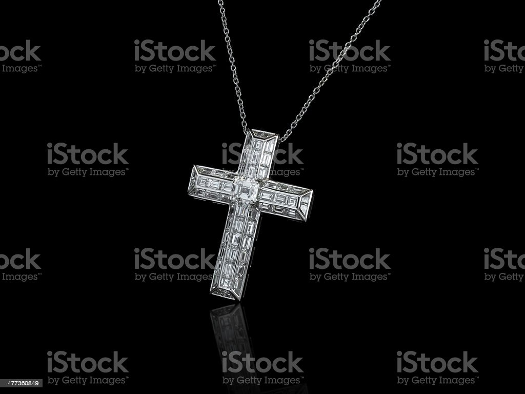 Jewelry cross with baguette diamonds royalty-free stock photo