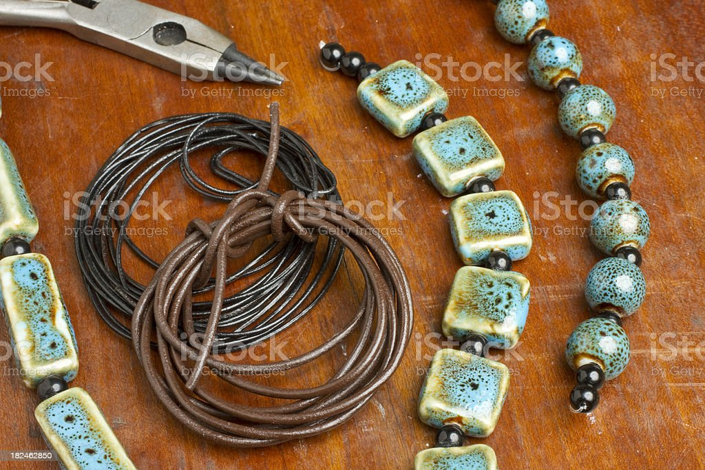 Jewelry Making Close-up With Beads, Leather Cord & Tools royalty-free stock photo