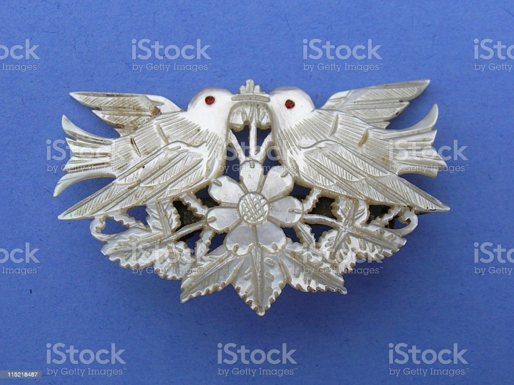 Jewelry: Mother of pearl doves. royalty-free stock photo