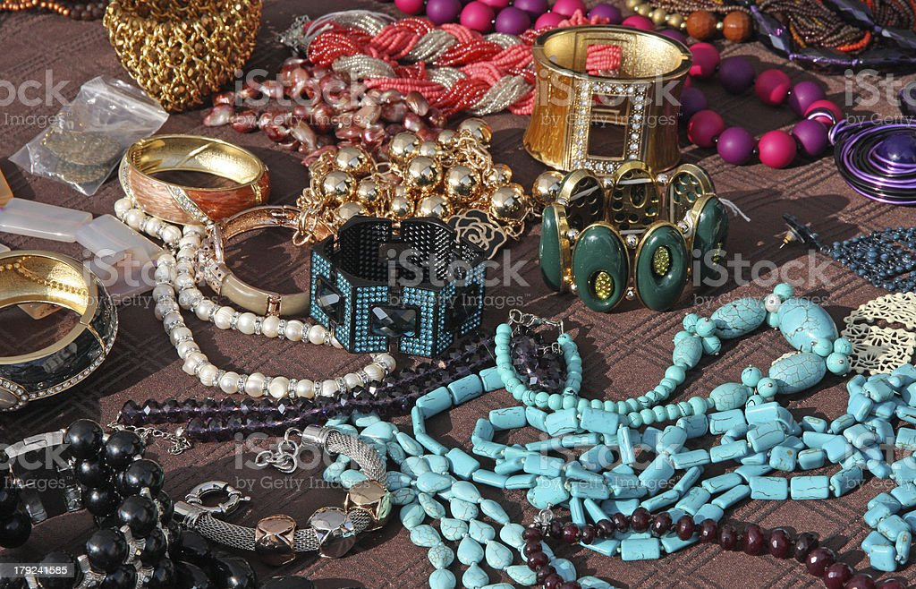 Jewelry necklaces and vintage bracelets for sale at flea market stock photo