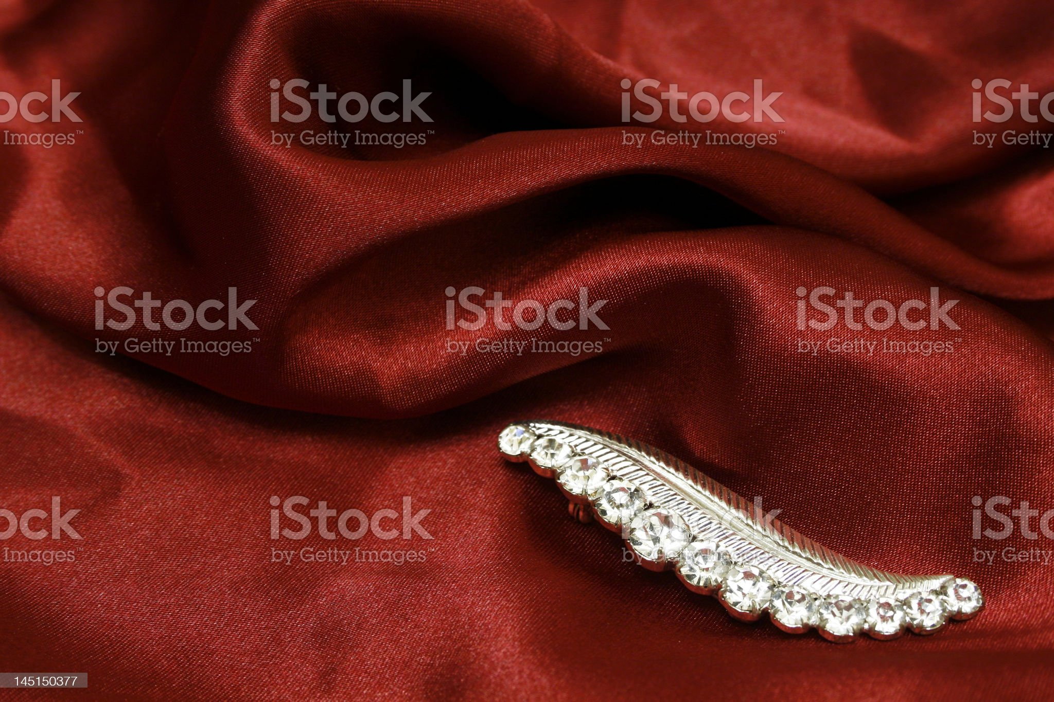 Jewelry on red silk royalty-free stock photo