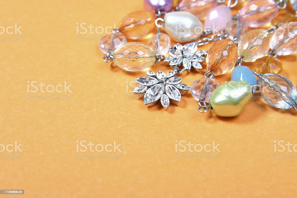 Jewelry on the yellow background royalty-free stock photo