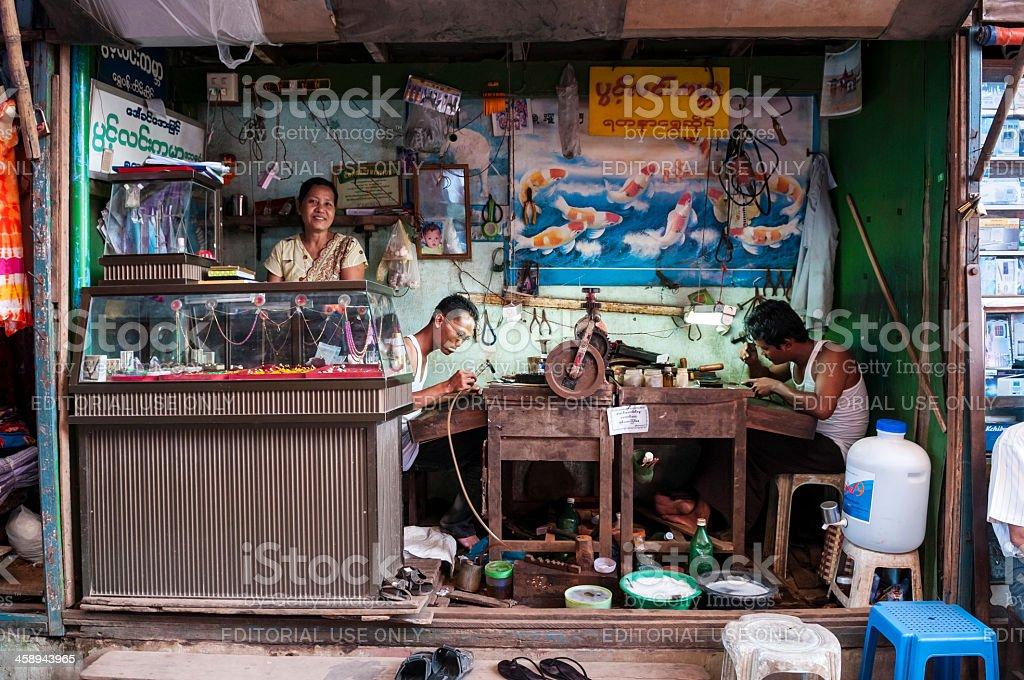 Jewelry repair workshop in Mawlamyine, Myanmar stock photo