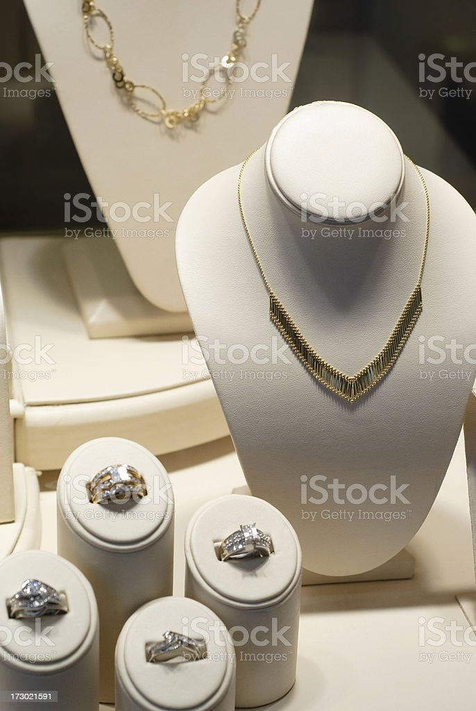 Jewelry Store Display Case with Necklaces and Diamond Rings royalty-free stock photo