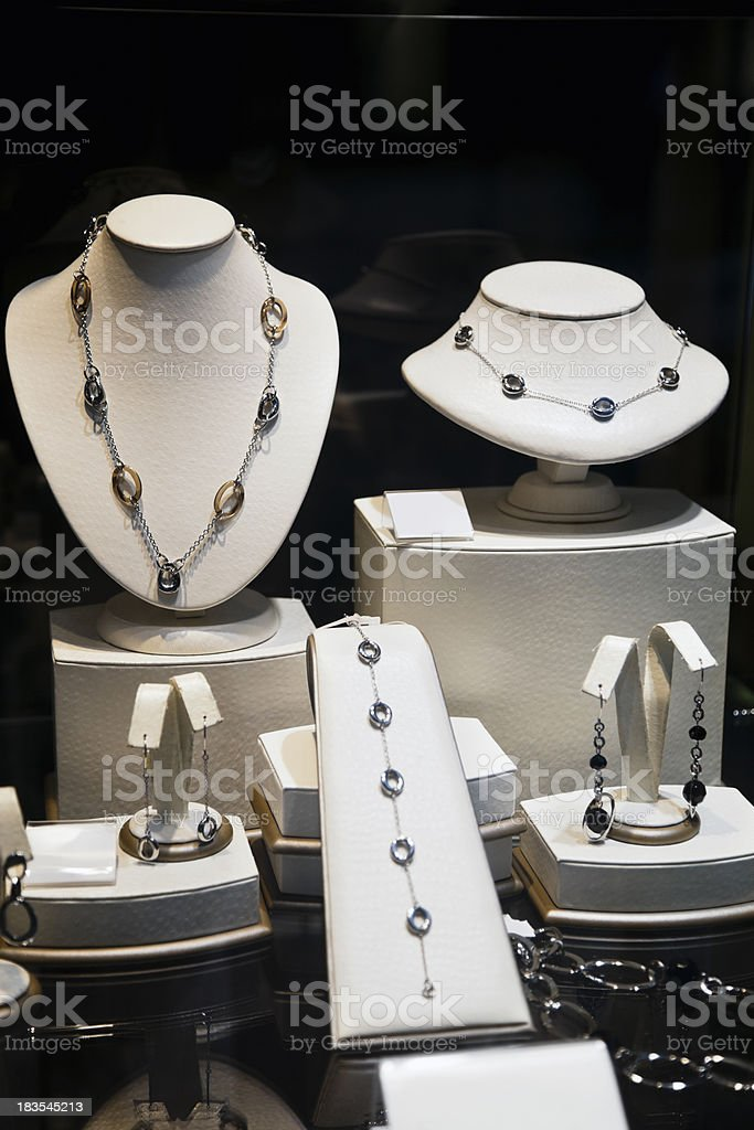 Jewelry Store Display Case with Necklaces and Earrings royalty-free stock photo