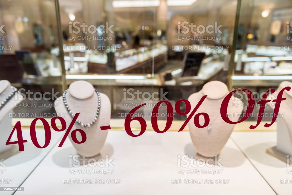 Jewelry store with 40 to 60 percent off discount sign on window display stock photo