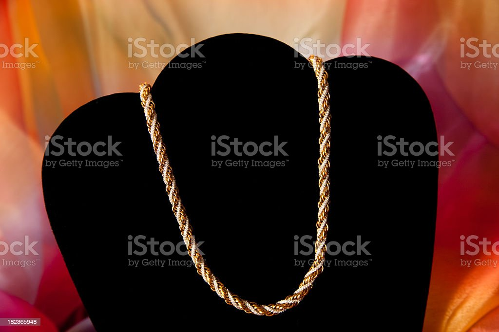 Jewelry Twisted gold and silver necklace on display royalty-free stock photo
