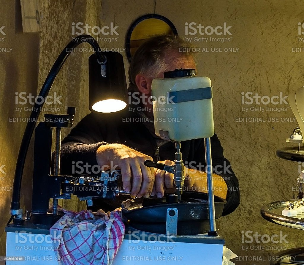 Jewels cutter faceting of gemstone stock photo