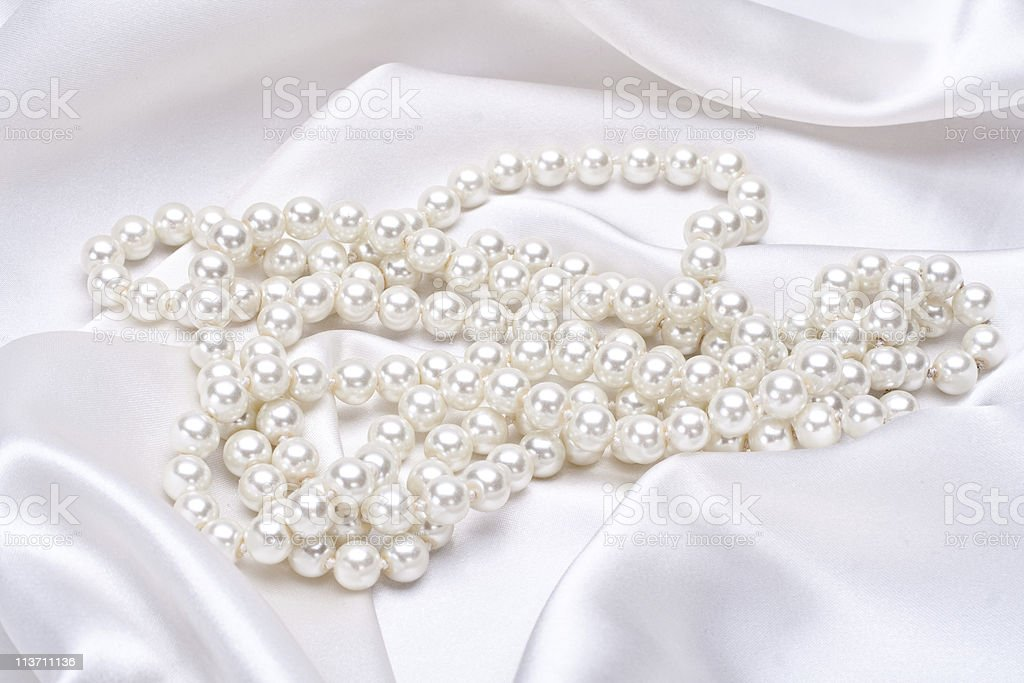 jewels on white satin stock photo
