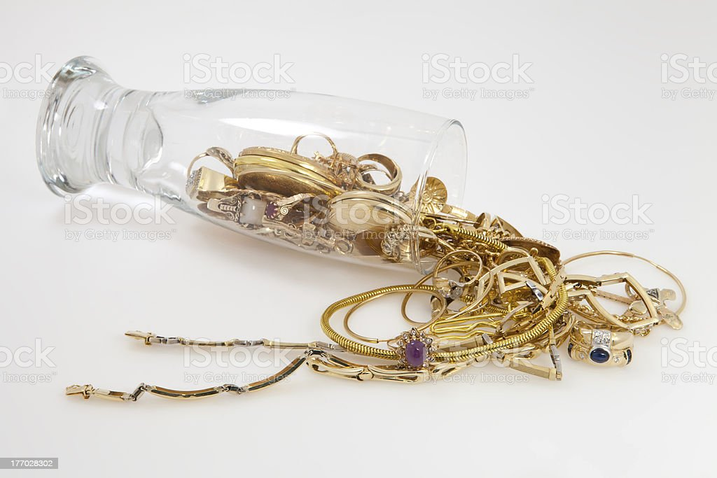 Jewels spilled from glass. stock photo