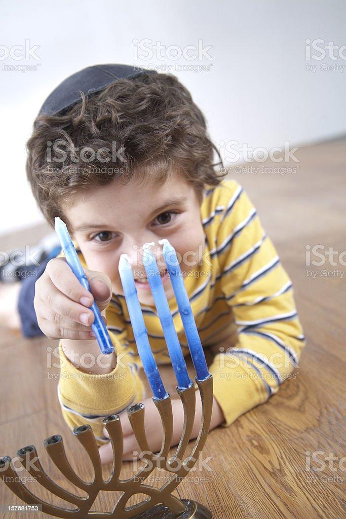 Jewish Boy Sets Up Hanukkah Menorah royalty-free stock photo