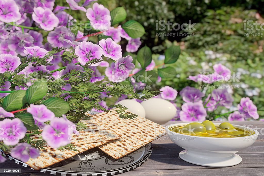 Jewish celebrate pesach passover with eggs,olive, matzo and flowers stock photo