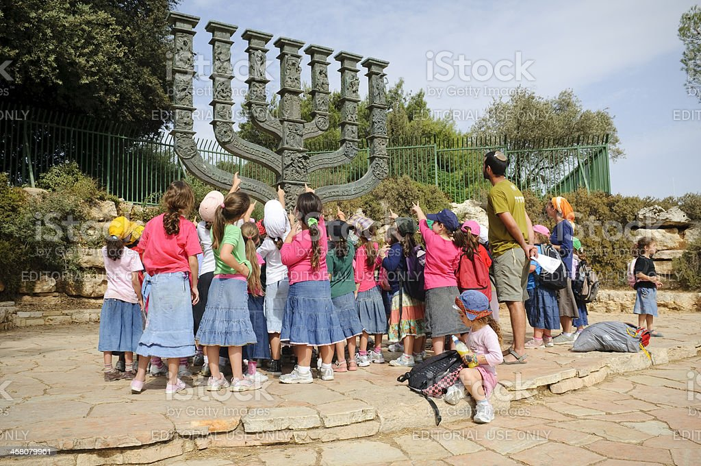 Jewish children and menorah stock photo