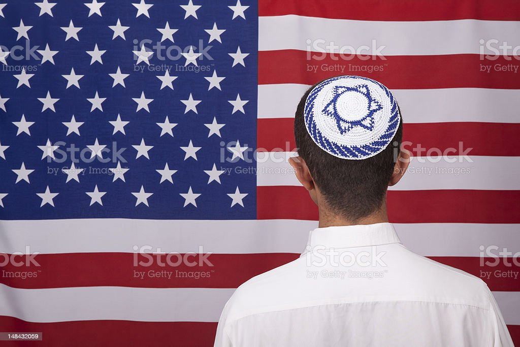 Jewish Citizen Wearing Yarmulke In Front Of American Flag stock photo