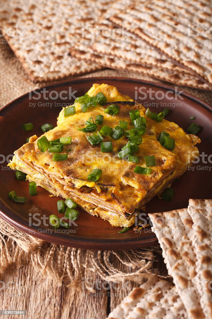 Jewish cuisine: matzah brei with green onions close-up. Vertical stock photo