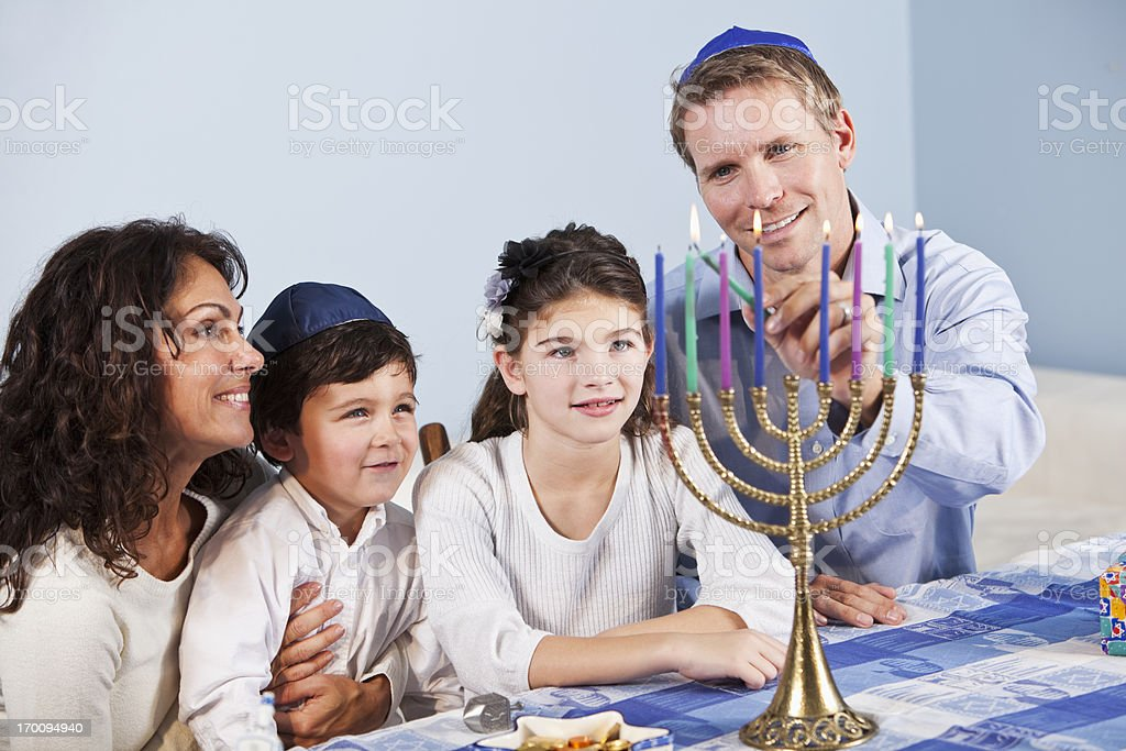 Jewish family celebrating Hanukkah stock photo