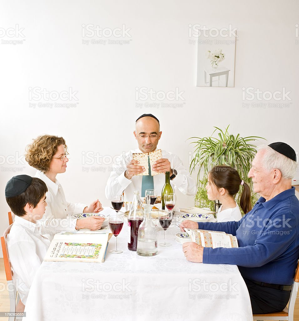 jewish family celebrating passover stock photo