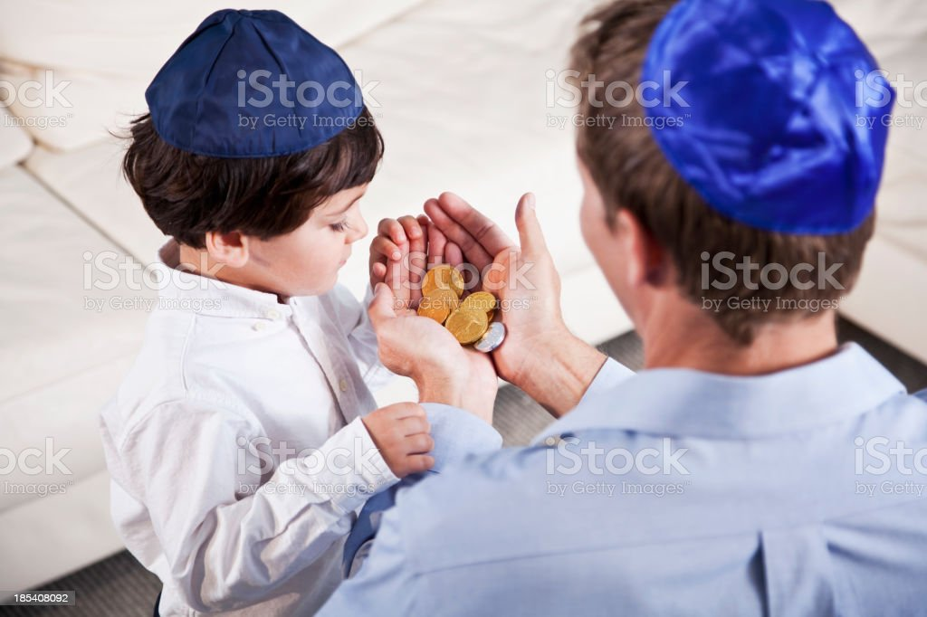 Jewish father and son with Hanukkah gelt stock photo