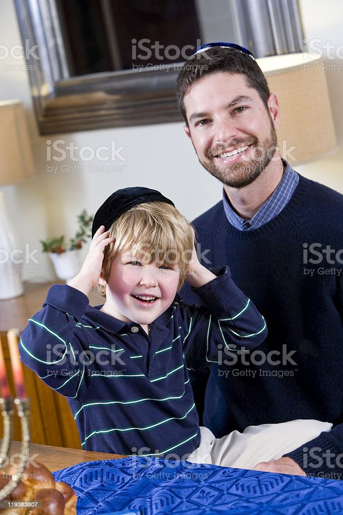 Jewish father and young son wearing yarmulkes stock photo