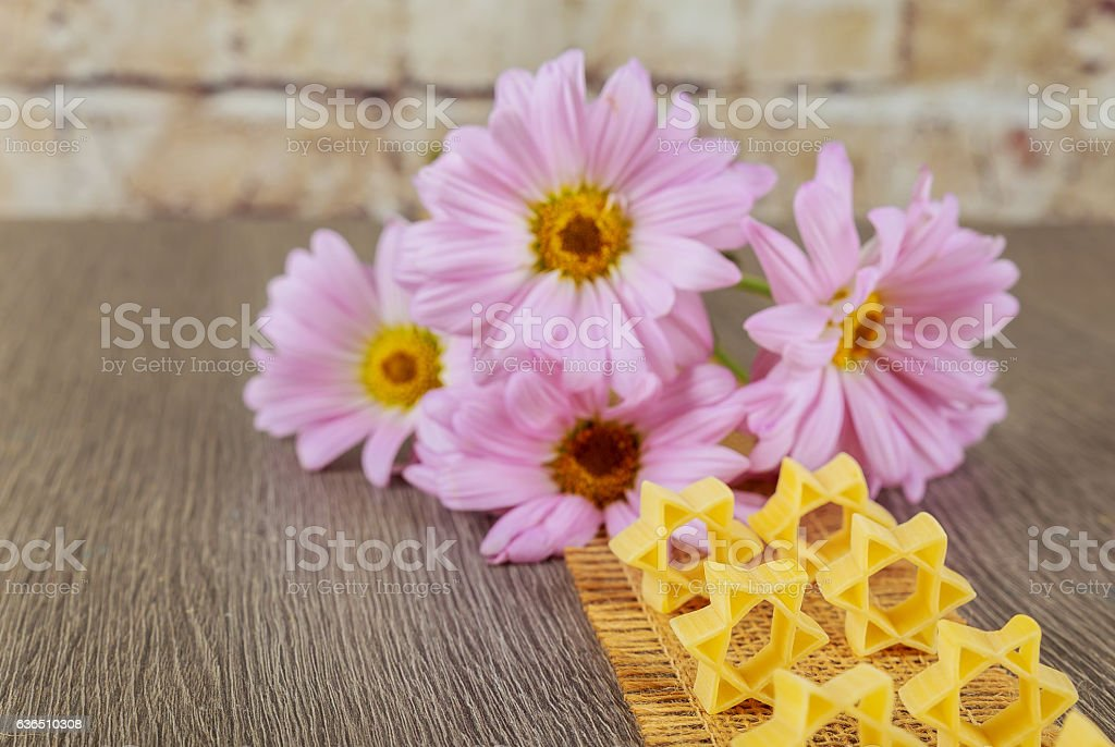 jewish food pasta for broth , a background of pink flowers stock photo