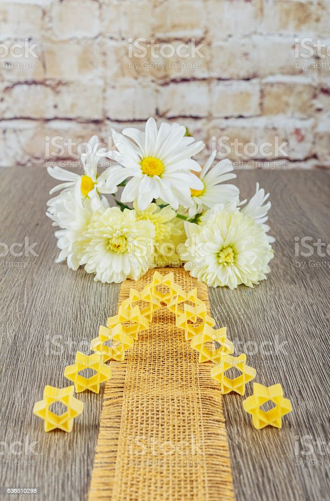 jewish food  pasta for broth , a background of white flowers stock photo