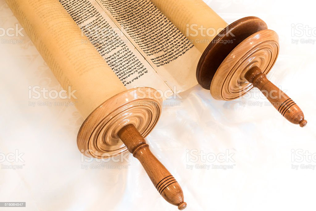 Jewish Hebrew handwritten Torah scroll, in synagogue stock photo