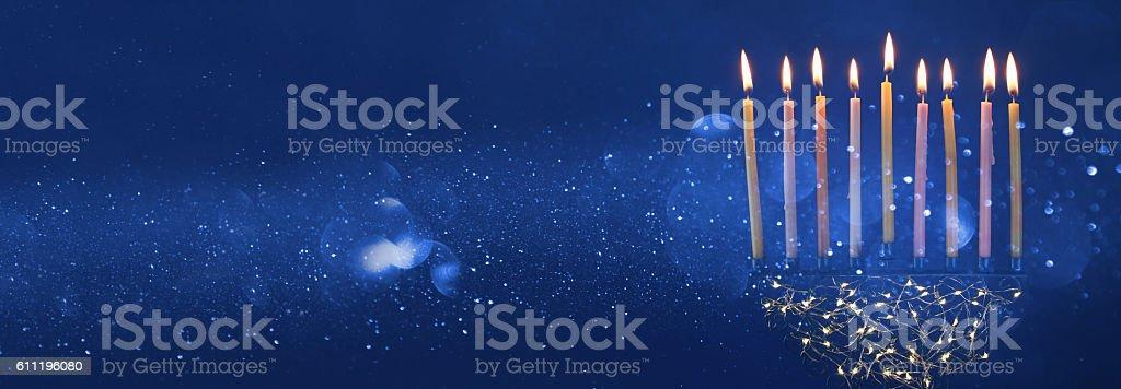 Low key Image of jewish holiday Hanukkah background with menorah and...