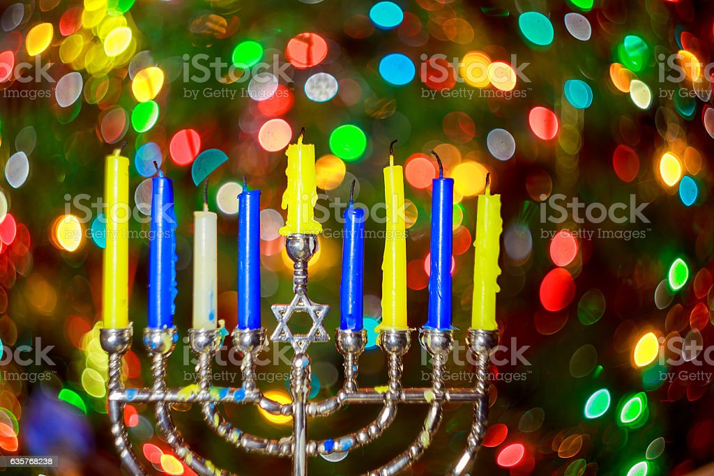 jewish holiday Hanukkah background with menorah traditional candelabra stock photo