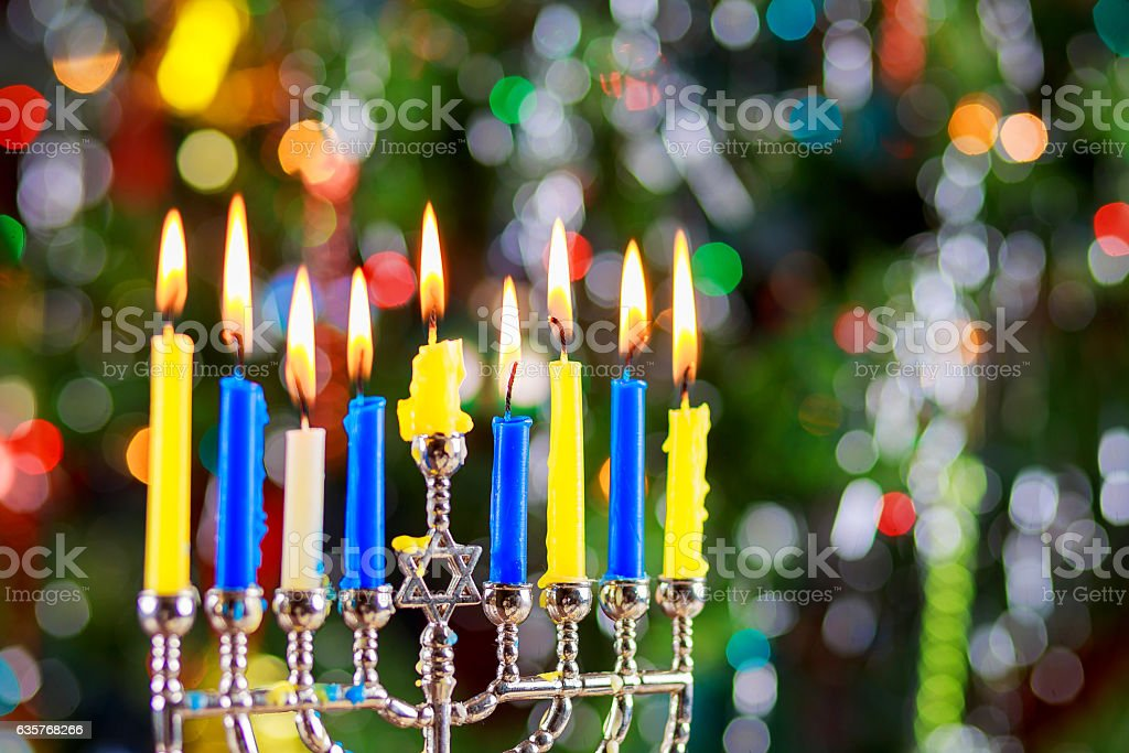 jewish holiday Hanukkah background with menorah traditional...