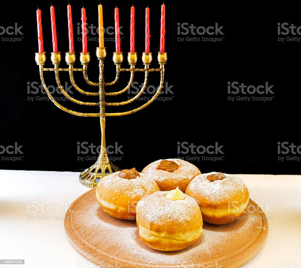 image of jewish holiday Hanukkah with menorah and doughnuts