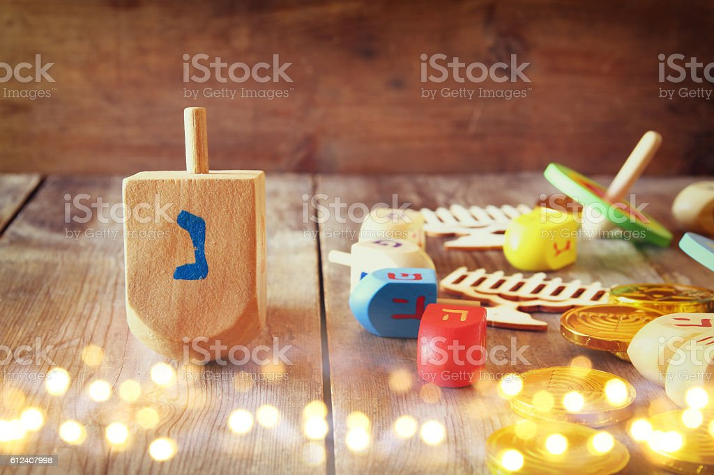 jewish holiday Hanukkah with dreidels (spinning top) and coins c stock photo