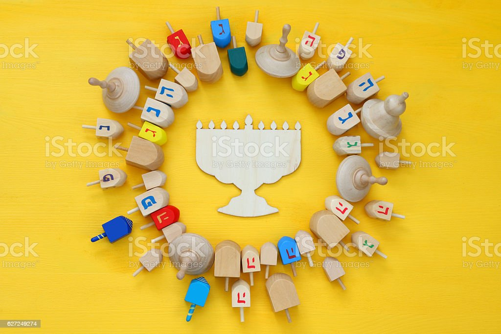 jewish holiday Hanukkah with dreidels (spinning top) stock photo