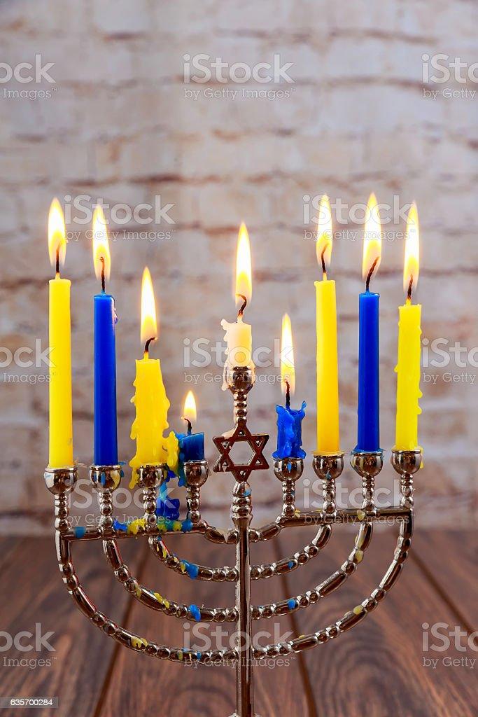 jewish holiday Hanukkah with menorah over wooden background Hanukkah...