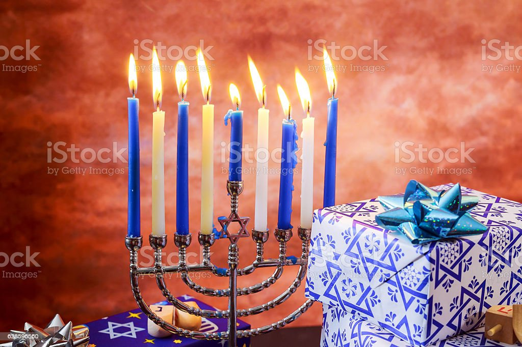 jewish holiday Hanukkah with menorah over wooden table Hanukkah...