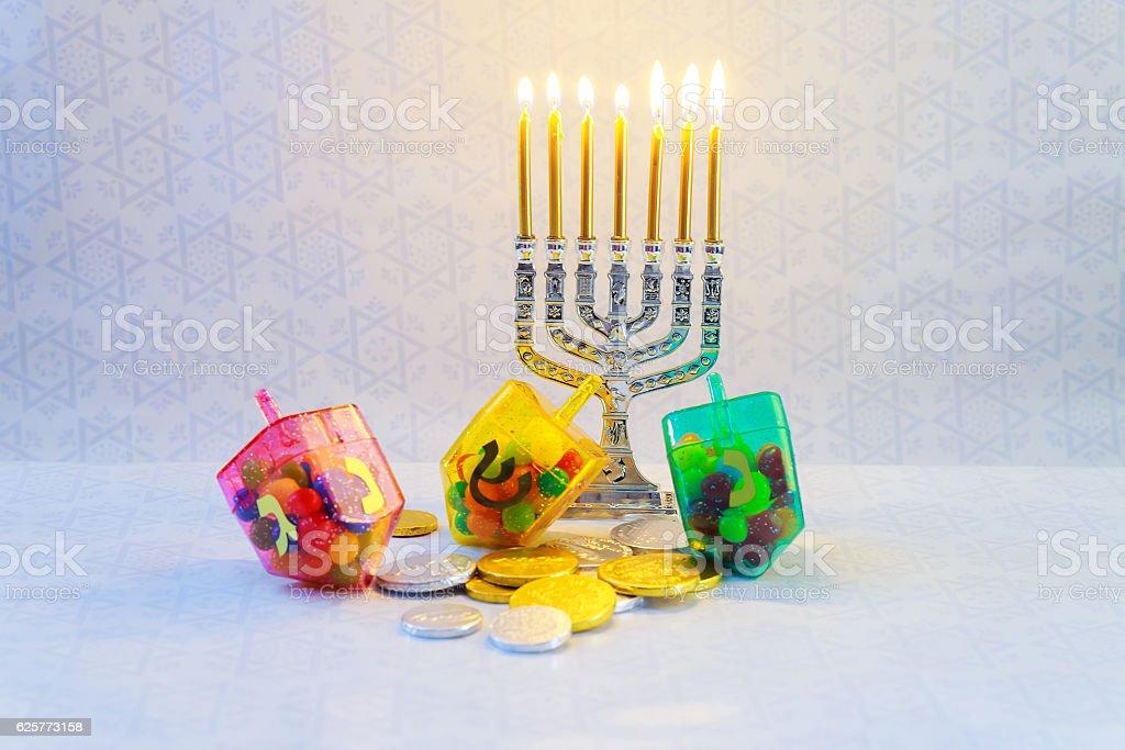 jewish holiday Hanukkah with menorah, wooden dreidels Hanukkah...