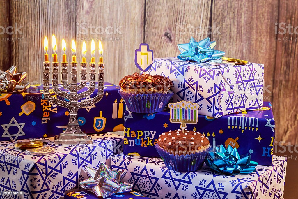 jewish holiday Hanukkah with menorah, wooden dreidels Hanukkah...