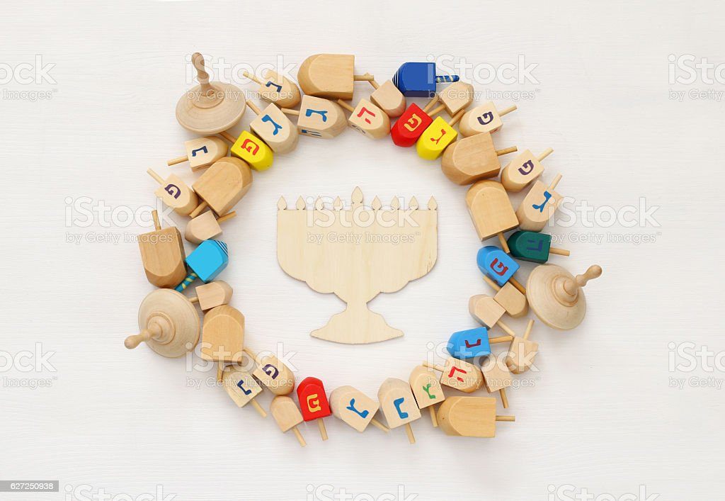 jewish holiday Hanukkah with wooden dreidels (spinning top) stock photo