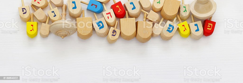 jewish holiday Hanukkah with wooden spinning tops stock photo