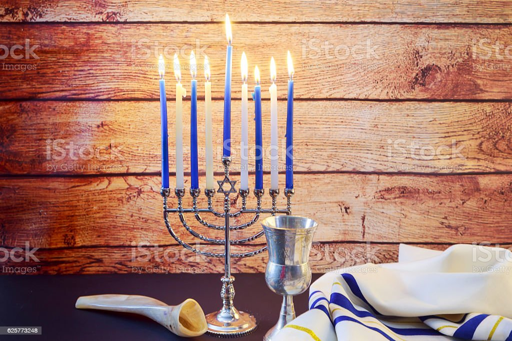 Jewish holiday HanukkahBeautiful Chanukah decorations blue and silver with gifts stock photo