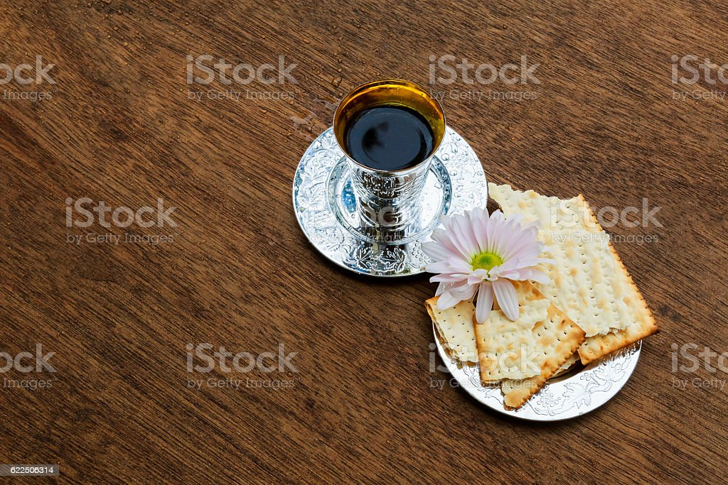 Jewish holiday Passover background with wine and seder plate stock photo