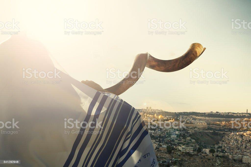 Jewish man blowing the Shofar in Jerusalm stock photo