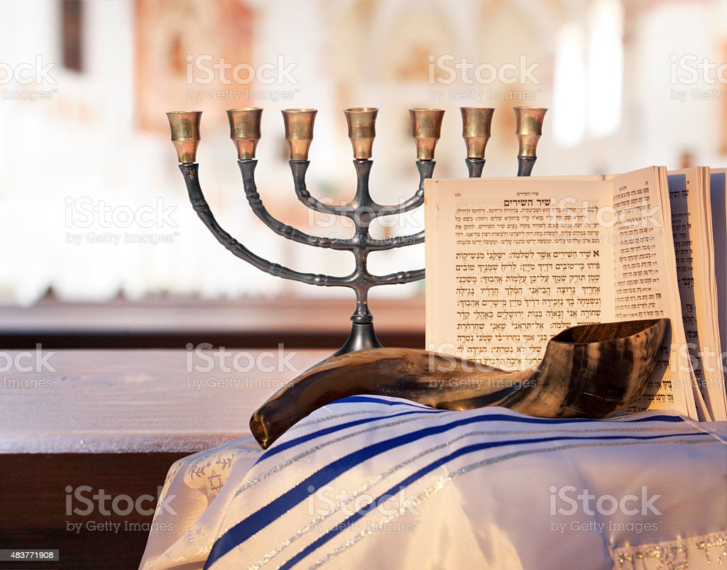 Jewish Menorah, Shofar, prayer book, and Talit stock photo