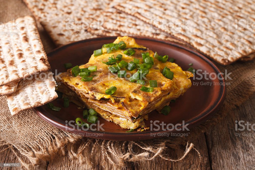 Jewish omelette: matzah brei with green onions close-up. horizontal stock photo